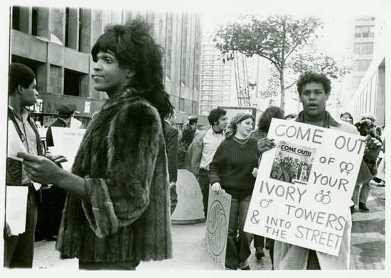 Queens Banding Together  Marsha P. Johnson handing out flyers in support of gay students at New York University, 1970.